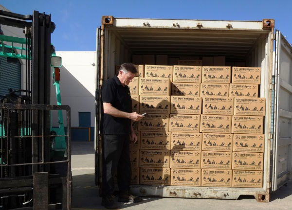 Peter Maher Packing Another Container Load Of Liquid Intelligence 115 Super Waterless Coolant To China - October 2014